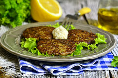 Liver and rice fritters with vegetables and cheese. Stock Images