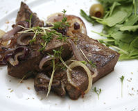 Liver. Some grilled liver with onions stock photography