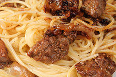 Liver and spagetti  -fine food background Royalty Free Stock Images