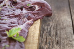 Liver with spices closeup. Sot on a wooden surface Stock Images