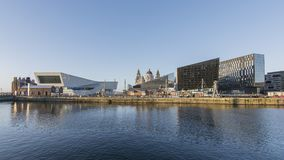 Liverpool Albert Dock - Waterfront. Museum of Liverpool and other modern buildings sit on the front of the dock. In the background are the historic Liver royalty free stock image