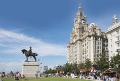 Liverpool waterfront with statue of Edward vii and Royal Liver Building. Liverpool as a summer tourist destination. A popular departure point for cruise ships stock photos