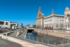 Liverpool Canal Link. A narrowboat crusing along the Liverpool central canal link at Pier Head with the Liver Building and ferry terminal in the background Stock Photography