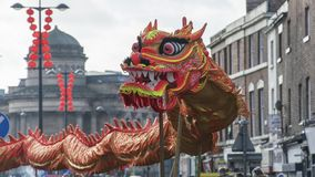 Liverpool Chinese New Year - Staring you out - Dragon Dancers on the streets of Liverpool royalty free stock image