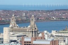 Liverpool. City in Merseyside county of North West England (UK). Aerial view with famous Royal Liver Building and offshore wind farm royalty free stock images