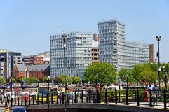 Liverpool Docks and city buildings. Stock Image