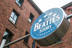 LIVERPOOL, ENGLAND - APRIL 20, 2012 : Sign of The Beatles Story. The famous museum and exhibition about the music band The Beatles royalty free stock image