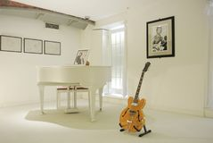 LIVERPOOL, ENGLAND - AUGUST 10, 2013: Interior of The Beatles St. Ory Museum at Liverpool, a famous white room of John Lennon where plays his song Imagine Stock Photos