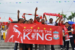 Liverpool fan. Kuala Lumpur July 16th : Supporters of Liverpool football club F.C. poses before the start of the friendly match between Liverpool FC and Malaysia Stock Images