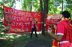 Liverpool fans have fun before UEFA Champions League Final. Kyiv, Ukraine - May 26, 2018: Liverpool fans have fun at Taras Shevchenko park in center of Kyiv city royalty free stock image