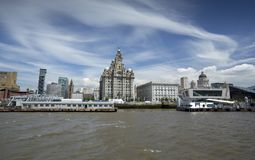 Liverpool, June 2014,  a scene across the River Mersey showing Pier Head, with the Royal Liver Building, Cunard Building and Port royalty free stock photography