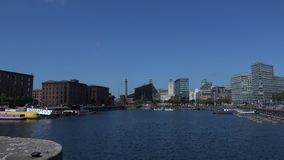 Liverpool looking at city from dock area 4K. Liverpool from the docks area with blue sky 4K stock video