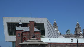 Liverpool museum new and old architecture side by side 4K. Liverpool from the docks area with blue sky new and old together 4K stock video