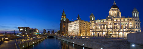Liverpool Panoramic. A twilight panoramic view of the Three Graces in Liverpool: The Royal Liver Building, Cunard Building and the Port of Liverpool Building Stock Photo