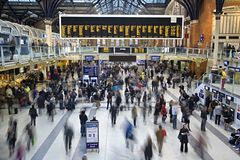 Liverpool Street station at rush hour. Liverpool Street rail and underground station at rush hour in London, United Kingdom. All identifiable faces and Royalty Free Stock Image
