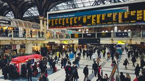 Liverpool street train station with lots of people, waiting for boarding, looking for information and walking through the hall stock photography