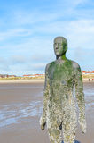Liverpool, UK - 03 April 2015 - Another Place sculpture of Antony Gormley on Crosby Beach Stock Photo