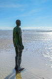 Liverpool, UK - 03 April 2015 - Another Place sculpture of Antony Gormley on Crosby Beach Royalty Free Stock Image