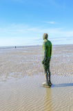 Liverpool, UK - 03 April 2015 - Another Place sculpture of Antony Gormley on Crosby Beach Royalty Free Stock Images