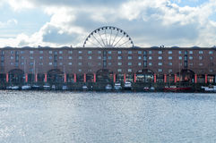 Liverpool, UK - 03 April 2015 - Albert Dock view with boats and Echo Eye of Liverpool royalty free stock photo