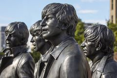 The Beatles Statue in Liverpool. Liverpool, UK - July 30th 2018: Statues of The Beatles - John Lennon, Ringo Starr, George Harrison and Paul McCartney - located stock photo