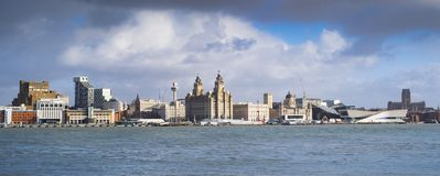 Liverpool waterfront and the river Mersey. Mix of architectural styles at Liverpool waterfront on a cloudy day royalty free stock images