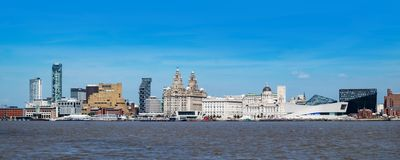 Liverpool waterfront and the river Mersey. Mix of architectural styles at Liverpool waterfront on a sunny day royalty free stock photo