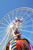 Liverpool wheel and Peace on Earth statue. Stock Photos