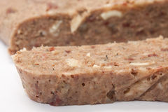 Liverwurst cut on a white background Stock Images