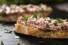 Liverwurst Sandwich with chopped parsley on a dark slate. Close up view Stock Image