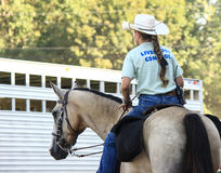 Livestock Control. A cowgirl works as livestock control at the state fair royalty free stock photography
