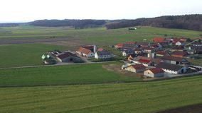 Livestock and dairy farms in a small village in Europe, Levanjci, county of Destrnik in Slovenia. Aerial view of eastern Slovenia`s rural countryside stock footage