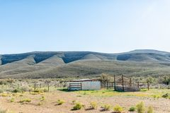 Livestock enclosures and loading ramp on road R356 to Ceres. A landscape, with livestock enclosures and loading ramp, on road R356 to Ceres in the Western Cape stock photo