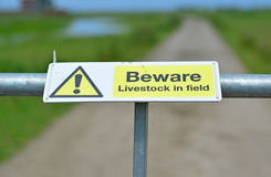 Livestock sign. A photo of a beware sign attached to a gate Stock Photos