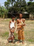 Living in Bangladesh. Family standing behind the hence in their land stock photo