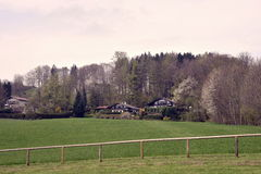 Living in bavaria. Idyllic view of some houses in the bavarian alps Royalty Free Stock Images