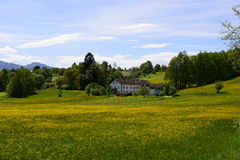 Living in bavaria. Idyllic view of some houses in the bavarian alps Royalty Free Stock Image