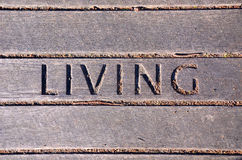 'Living' carved in wooden boards Stock Photo