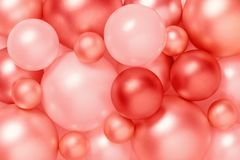 Living coral color background of metallic Christmas balls. Trendy composition, color of the 2019 year stock photography