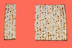 Living Coral color of the Year 2019. Matza Pesach celebration symbol on trendy color background. royalty free stock photos