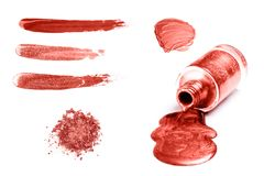 Swatches of cosmetic products in trendy coral color. stock images