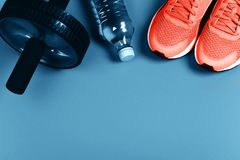 Living Coral sneakers on blue background. stock photo