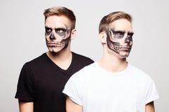 Living dead tweens. Tween brothers with skeleton-face makeup Stock Photography