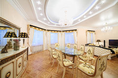 Living and dining room with luxury gilt furniture. In classic style Royalty Free Stock Photography