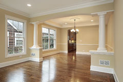 Living and dining room with white pillars. In new construction home Royalty Free Stock Photo