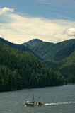 Living the Dream. Fishing boat South Bound in the Inside Passage Royalty Free Stock Image