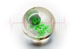 Living Earth with heartbeat and green pills. Crystal ball globe with heartbeat trace and green pills stock photo
