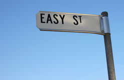 Living on Easy Street. Easy Street Sign on Blue Sky Background with copy space below stock photos