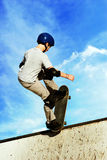 Living on the edge. Boy skateboarding royalty free stock images