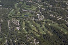 Living on the golf course. Aerial view of a golf course and attached housing Stock Images